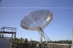 N7AM 30' dish tracking the moon.  You can see the platform he uses for working on the feed to the left.  Ropes hang down from the edges of the dish to tied it down when not in use.